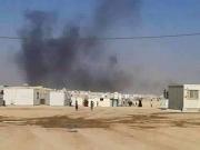 بالصور اشتعال كرفانات في الزعتري